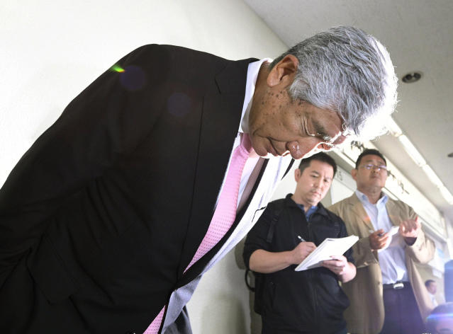 Nihon University head coach Masato Uchida apologizes as he speaks to reporters at Osaka International Airport in Osaka, western Japan Saturday, May 19, 2018. Uchida said he would resign to take responsibility for the hit in which one of his players tackled Kwansei Gakuin's quarterback from behind long after he had released the ball. (Nobuki Ito/Kyodo News via AP)