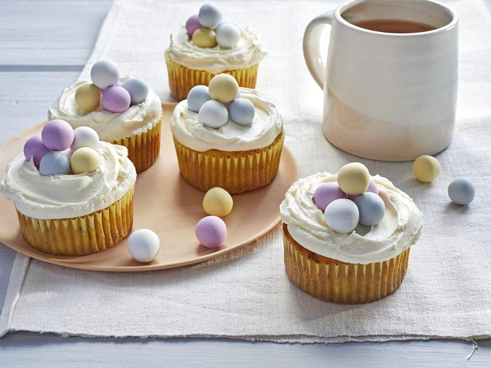 """<p><strong>Recipe: <a href=""""https://www.southernliving.com/recipes/carrot-cake-cupcakes"""" rel=""""nofollow noopener"""" target=""""_blank"""" data-ylk=""""slk:Carrot Cake Cupcakes with Buttercream-Cream Cheese Frosting"""" class=""""link rapid-noclick-resp"""">Carrot Cake Cupcakes with Buttercream-Cream Cheese Frosting</a></strong></p> <p>Spring into the season with this festive dessert that makes easy, individual servings. Inspired by a <a href=""""https://www.southernliving.com/recipes/ultimate-carrot-cake-recipe"""" rel=""""nofollow noopener"""" target=""""_blank"""" data-ylk=""""slk:classic carrot cake"""" class=""""link rapid-noclick-resp"""">classic carrot cake</a>, these light, fluffy carrot cake cupcakes are infused with even more bright flavor with the moist Pineapple Filling. Finish them off with adorable eggs for easter or simply pipe the Buttercream-Cream Cheese Frosting on top in whatever design you'd like for a slice-free, party-ready dessert. </p>"""