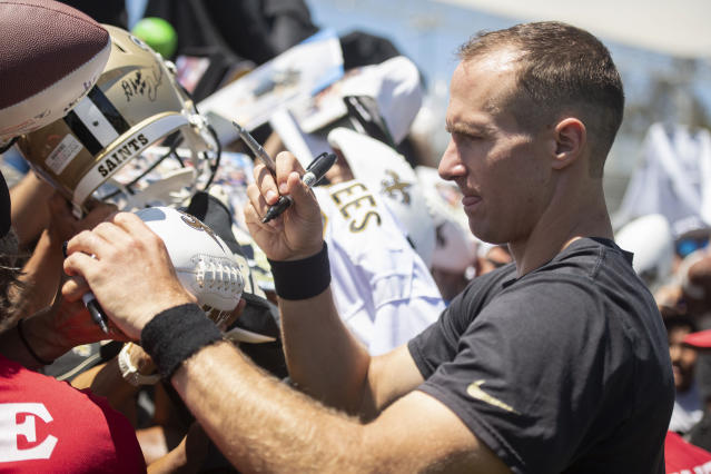 New Orleans Saints quarterback Drew Brees signs autograph to the fans after a joint NFL football practice with the Los Angeles Chargers in Costa Mesa, Calif., Thursday, Aug. 15, 2019. (AP Photo/Kyusung Gong)