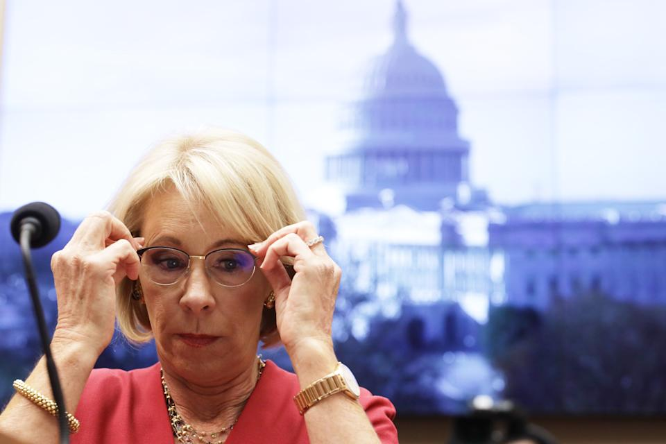 """WASHINGTON, DC - DECEMBER 12:  U.S. Secretary of Education Betsy DeVos waits for the beginning of a hearing before House Education and Labor Committee December 12, 2019 on Capitol Hill in Washington, DC. The committee held a hearing on """"Examining the Education Department's Implementation of Borrower Defense.""""  (Photo by Alex Wong/Getty Images)"""