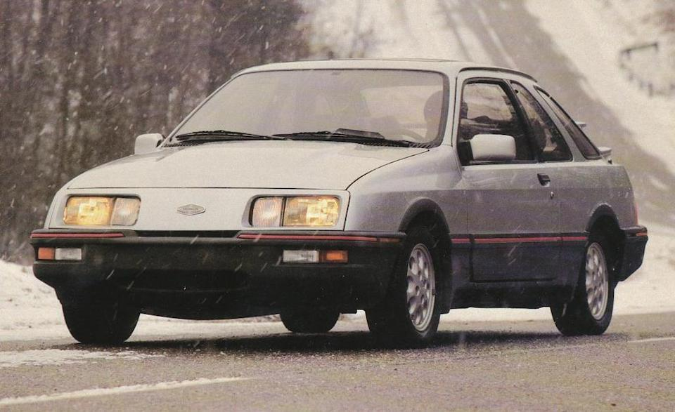 """<p>Of all the European and British Ford models federalized for sale in the U.S. over the years, the Merkur XR4Ti was arguably the most misunderstood. Named to <a href=""""http://www.caranddriver.com/features/1985-10best-cars"""" rel=""""nofollow noopener"""" target=""""_blank"""" data-ylk=""""slk:our 10Best list"""" class=""""link rapid-noclick-resp"""">our 10Best list</a> in its inaugural year of 1985, <a href=""""http://www.caranddriver.com/reviews/rapido-merkur-xr4ti-archived-test-review"""" rel=""""nofollow noopener"""" target=""""_blank"""" data-ylk=""""slk:the Merkur XR4Ti's arrival party was a bona fide celebration"""" class=""""link rapid-noclick-resp"""">the Merkur XR4Ti's arrival party was a bona fide celebration</a>. By the time production models began to fill showrooms, magazines and enthusiasts were boldly asserting that Ford had finally managed to capture some Euro-bred swagger that would appeal to the emerging yuppie demographic that was defecting en masse from domestic vehicles to sports sedans by BMW and Audi.<br></p>"""