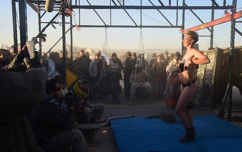 Festival goers enjoy a burlesque performance on the first day of Wasteland Weekend in the Mojave Desert, California, the largest post-apocalyptic themed festival in the world (AFP Photo/Frederic J Brown)
