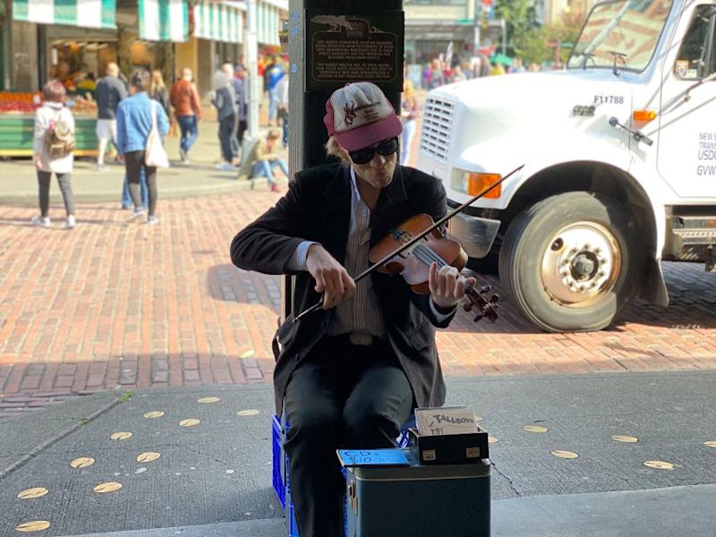a performer at the Seattle market