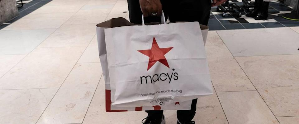 Closeup of Macy's shopping bag, being held by person out of frame