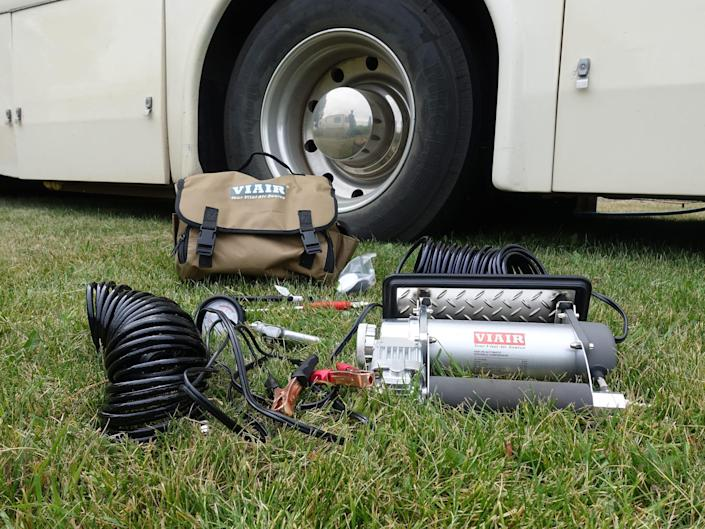 Air compressor kit in the grass in front of the RV