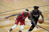 New Orleans Pelicans forward Brandon Ingram loses the ball to Miami Heat forward Jimmy Butler (22) during the second half of an NBA basketball game in New Orleans, Thursday, March 4, 2021. The Heat won 103-93. (AP Photo/Gerald Herbert)