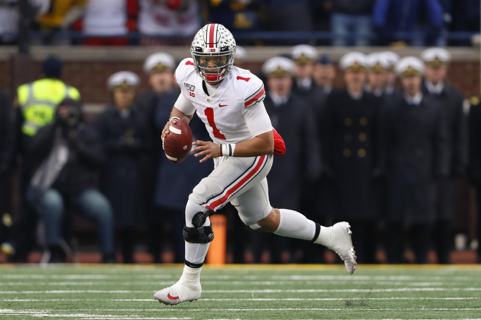 Ohio State quarterback Justin Fields rolls out to pass against Michigan in 2019. (AP Photo/Paul Sancya)