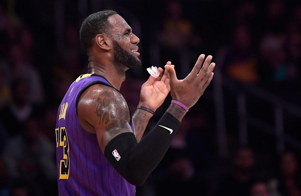 Los Angeles Lakers forward LeBron James reacts after being called for a foul during the first half of an NBA basketball game against the Brooklyn Nets Friday, March 22, 2019, in Los Angeles. (AP Photo/Mark J. Terrill)