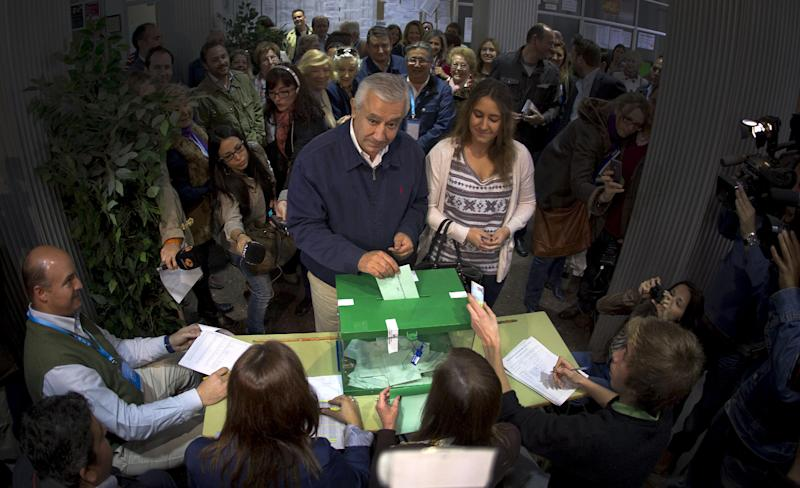 Conservative Popular Party candidate Javier Arenas casts his vote for the Andalusian elections at a polling station in Seville, Spain, Sunday March 25, 2012. Spaniards are voting in regional elections that could see the conservative Popular party oust Socialist opponents from office in the latter's traditional power base of Andalucia. More than 7 million voters are called to go to the polls Sunday in the southern region and also in northern Asturias. (AP Photo/Miguel Angel Morenatti)