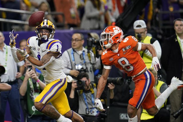 LSU wide receiver Ja'Marr Chase catches a touchdown pass in front of Clemson cornerback A.J. Terrell during the first half of the College Football Playoff national championship game on Jan. 13, 2020, in New Orleans. (AP Photo/David J. Phillip)