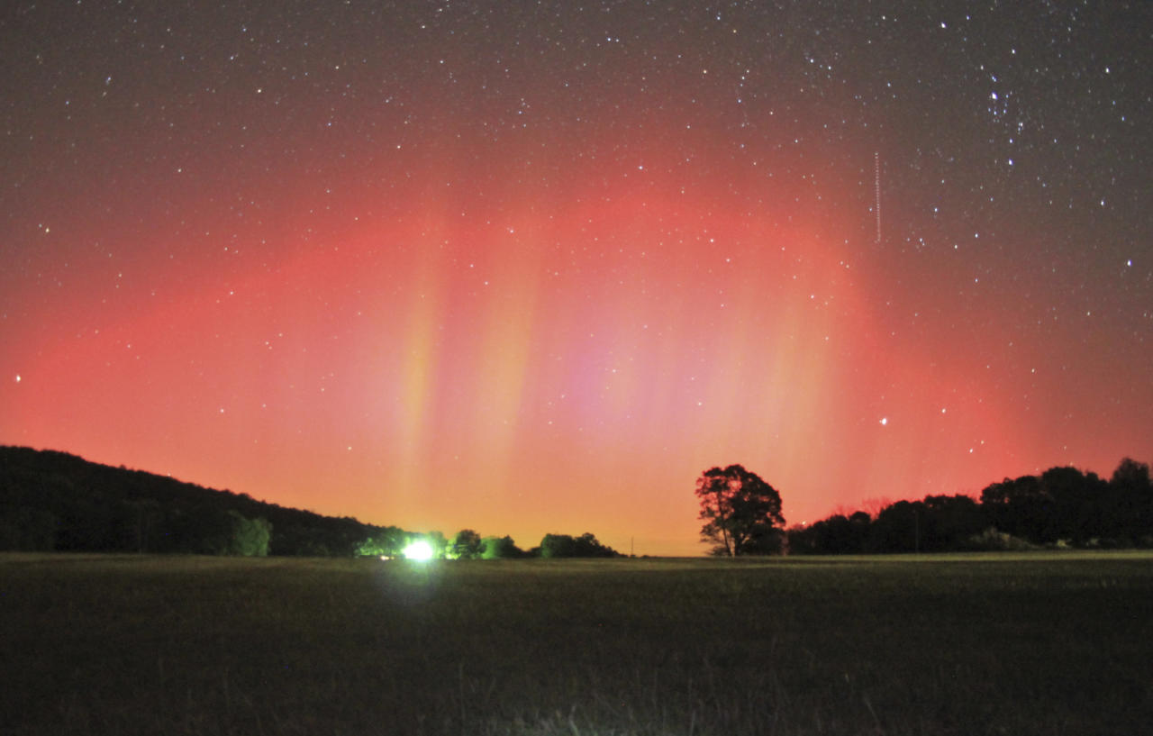 In this photo provided by Brian Emfinger, aurora borealis lights up the Ozark, Ark. sky on Monday, Oct. 24, 2011. Emfinger, a storm chaser, said this is only the second northern lights in a decade that he has seen this far south. (AP Photo/realclearwx.com, Brian Emfinger)