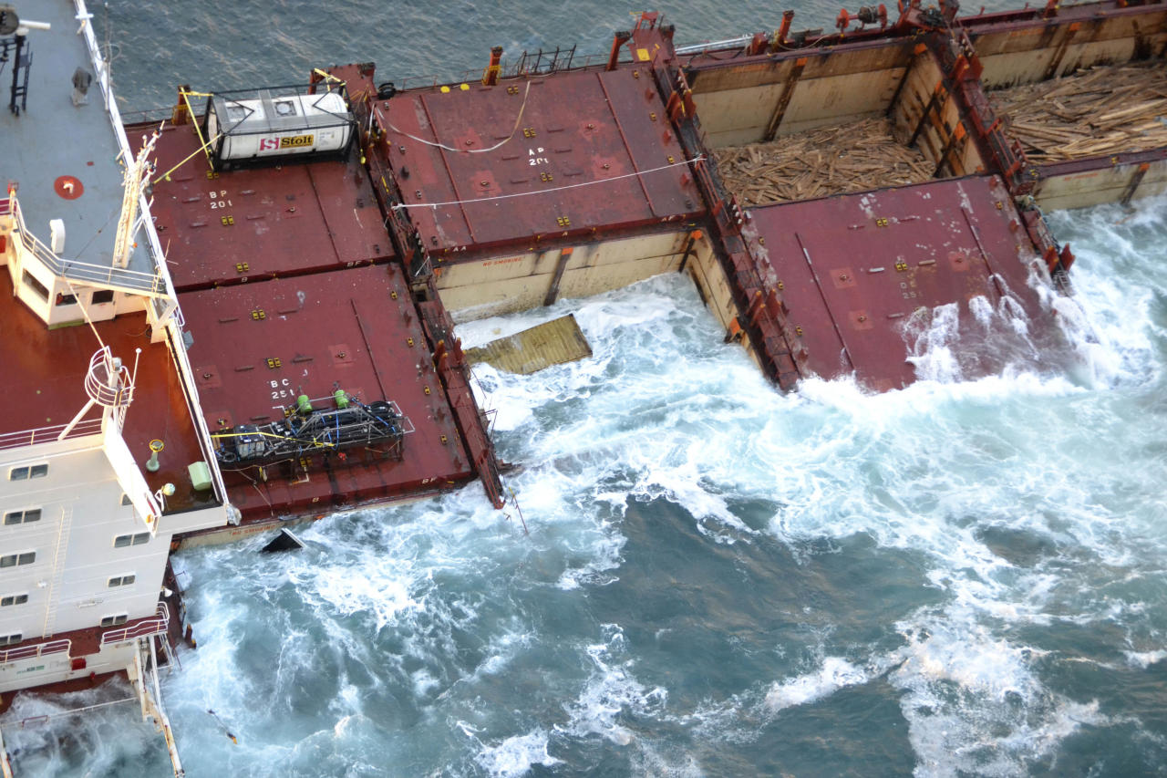In this photo provided by Maritime New Zealand, half of the cargo ship Rena is partially submerged on a reef near Tauranga, New Zealand, Tuesday, Jan. 10, 2012. The 774-foot (236-meter) vessel split in two over the weekend amid heavy seas and now the stern section is slipping from the Astrolabe reef and sinking. (AP Photo/Maritime New Zealand) EDITORIAL USE ONLY