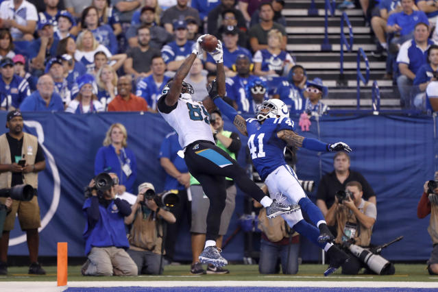 <p>Jacksonville Jaguars tight end Marcedes Lewis (89) catches a pass in the end zone for a touchdown against Indianapolis Colts safety Matthias Farley (41) at Lucas Oil Stadium. Mandatory Credit: Brian Spurlock-USA TODAY Sports </p>