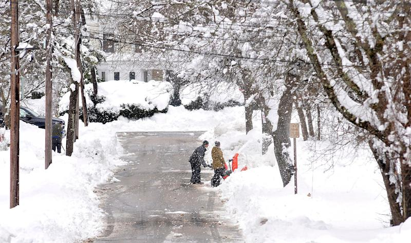 Neighbors dig out a driveway on Rockhill Street in Foxboro, Massachusetts, Monday, March 4, 2019, after the area received well over a foot of snow in an overnight storm.