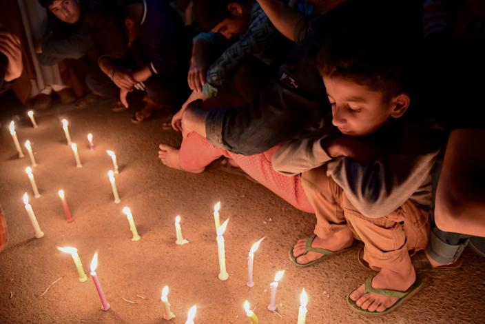 """SRINAGAR, JAMMU AND KASHMIR, INDIA - 2019/04/28: Kashmiri Shia Muslims seen lighting candles during a protest in Srinagar. Shia protesters held a candle light vigil in Srinagar against the mass execution of 37 individuals in Saudi Arabia. According to Saudi Press Agency, those executed were accused of """"forming a terrorist cell"""" and attacking a security outpost, killing a number of officers. (Photo by Idrees Abbas/SOPA Images/LightRocket via Getty Images)"""