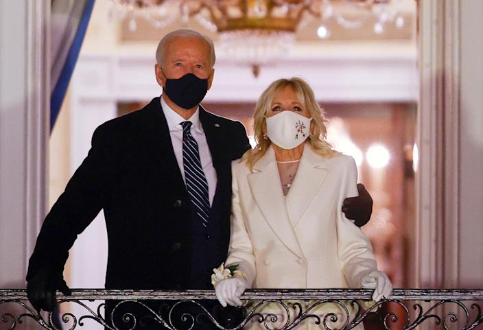 <p>US President Joe Biden and first lady Jill Biden watch fireworks from the White House after his inauguration as the 46th President of the country</p> (Reuters)