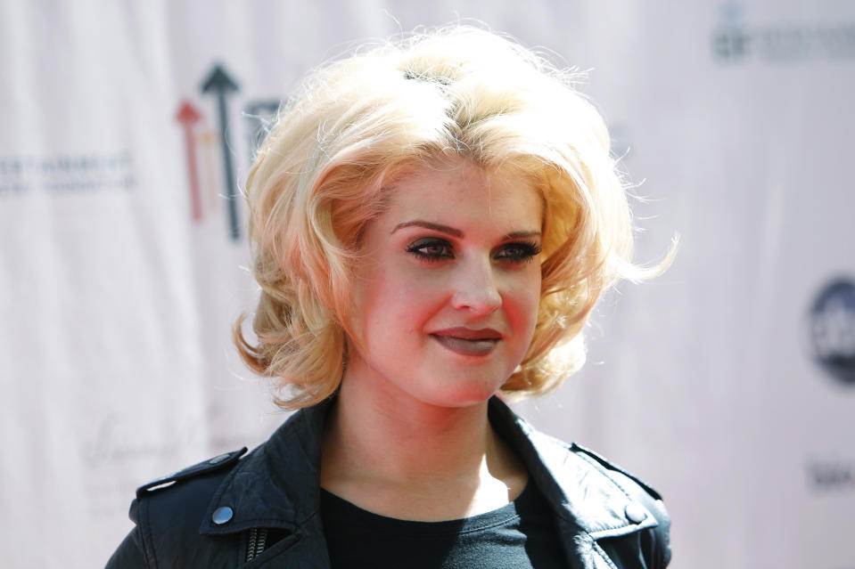 """Kelly Osbourne poses at the """"Stand Up To Cancer"""" television event aimed at raising funds to accelerate innovative cancer research at the Sony Studios Lot in Culver City, California, September 10, 2010. The one-hour live commercial-free fundraising event was aired across multiple broadcast and cable channels at the same time. REUTERS/Danny Moloshok (UNITED STATES - Tags: ENTERTAINMENT HEALTH HEADSHOT)"""
