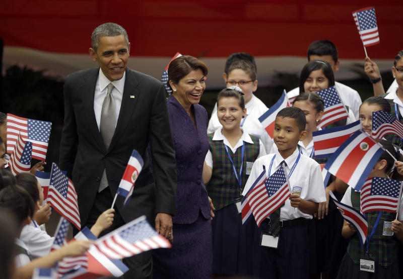 President Barack Obama and Costa Rica President Laura Chinchilla attend a cultural event with youth performing at the Casa Amarilla in San Jose, Costa Rica, Friday, May 3, 2013. (AP Photo/Pablo Martinez Monsivais)