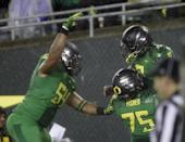 Oregon running back Byron Marshall, right, celebrates his touchdown with teammates Hamani Stevens, left, and Jake Fisher during the first half of an NCAA college football game against California in Eugene, Ore., Saturday, Sept. 28, 2013. (AP Photo/Don Ryan)