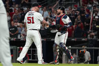 Atlanta Braves relief pitcher Will Smith (51) and Atlanta Braves catcher Travis d'Arnaud (16) celebrate after defeating the Philadelphia Phillies in a baseball game Tuesday, Sept. 28, 2021, in Atlanta. (AP Photo/John Bazemore)