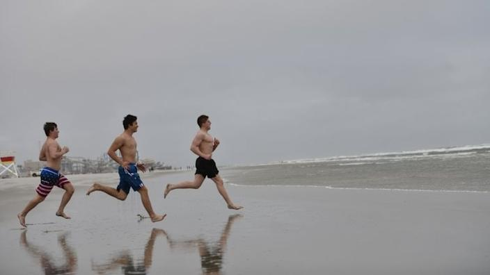 In New Jersey, some beach goers brave the cold weather after the state beaches opened - albeit with some restrictions