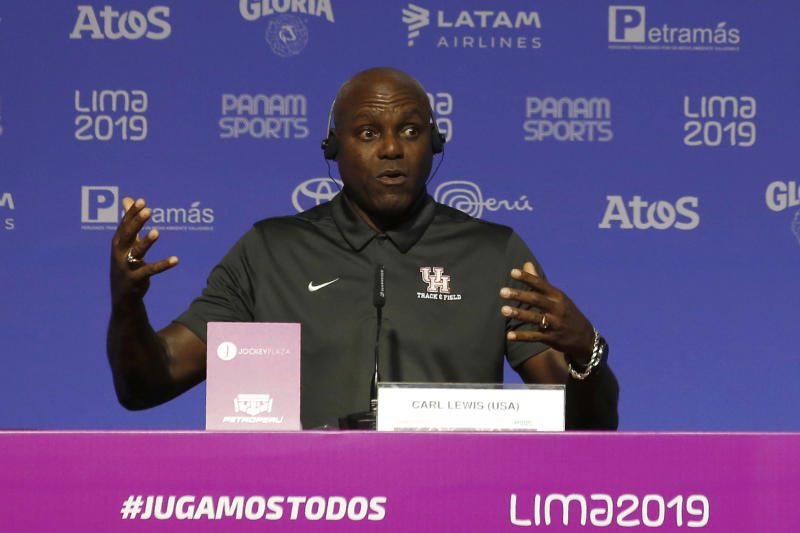 Nine-time Olympic gold medalist Carl Lewis, from the United States, speaks during a press conference during the Pan American Games in Lima, Peru, Monday, Aug. 5, 2019. Lewis said that if it wasn't for his mother, who competed in the first Pan Am Games in 1951, he would have never chosen athletics. (AP Photo/Moises Castillo)