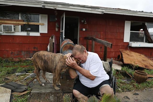 """<p>Steve Culver cries with his dog Otis as he talks about what he said was the, """"most terrifying event in his life,"""" when Hurricane Harvey blew in and destroyed most of his home while he and his wife took shelter there on Aug. 26, 2017 in Rockport, Texas. (Photo: Joe Raedle/Getty Images) </p>"""