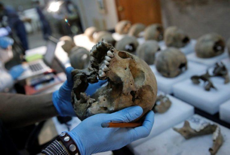 The National Institute of Anthropology and History (INAH) determined some of the skulls belonged to women and children (Reuters)
