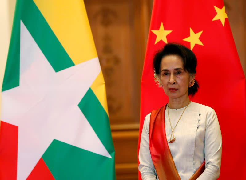 Myanmar State Counselor Aung San Suu Kyi waits for arrival of Chinese President Xi Jinping (not pictured) at the Presidential Palace in Naypyitaw