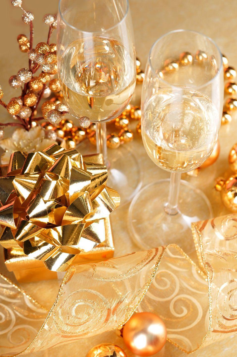 """<p>Toast the arrival of 2021 with the best part of the New Year's holiday: the champagne! Deck out your house with gold-themed everything, like these <a href=""""https://www.amazon.com/GOER-711176740583-Foil-Fringe-Curtains/dp/B01J9FWFC2/?creativeASIN=B01J9FWFC2&linkCode=w61&imprToken=Ke3w.YliaKFz5yG3okk5PA&slotNum=11&tag=syn-yahoo-20&ascsubtag=%5Bartid%7C10055.g.30105731%5Bsrc%7Cyahoo-us"""" rel=""""nofollow noopener"""" target=""""_blank"""" data-ylk=""""slk:gold fringe curtains"""" class=""""link rapid-noclick-resp"""">gold fringe curtains</a> and <a href=""""https://www.amazon.com/XmasExp-Balloon-Garland-Balloons-Wedding/dp/B07RXYMN9C/ref=sr_1_5?keywords=champagne+bottle+balloon&qid=1575389712&s=home-garden&sr=1-5&tag=syn-yahoo-20&ascsubtag=%5Bartid%7C10055.g.30105731%5Bsrc%7Cyahoo-us"""" rel=""""nofollow noopener"""" target=""""_blank"""" data-ylk=""""slk:champagne bottle balloons"""" class=""""link rapid-noclick-resp"""">champagne bottle balloons</a> — and of course, lots and <em>lots</em> of bubbly. You can even feature champagne in other foods, like these delicious <a href=""""https://www.delish.com/cooking/recipe-ideas/recipes/a57361/champagne-cupcakes-recipe/"""" rel=""""nofollow noopener"""" target=""""_blank"""" data-ylk=""""slk:champagne cupcakes"""" class=""""link rapid-noclick-resp"""">champagne cupcakes</a> that are almost too pretty to eat.</p>"""