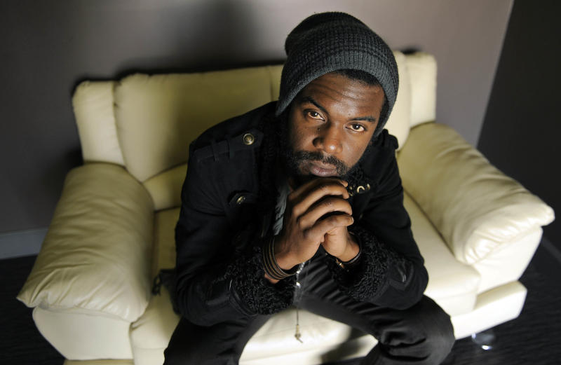 "This Oct. 23, 2012 photo shows guitarist Gary Clark Jr. posing for a portrait at The BLVD Hotel in Los Angeles. Clark's latest album, ""Blak and Blu,"" was released this week. (Photo by Chris Pizzello/Invision/AP)"