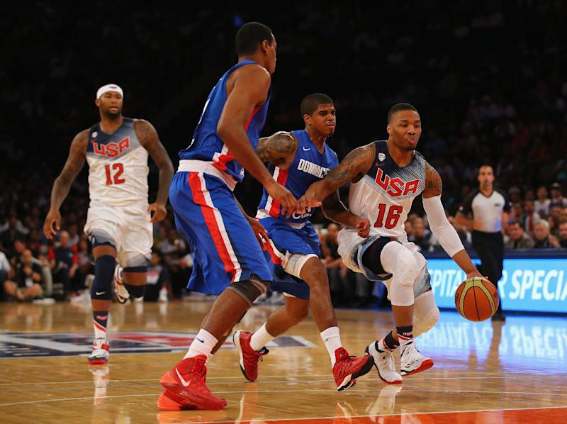 Damian Lillard (No. 16) of the USA drives to the basket against the Dominican Republic during their game at Madison Square Garden in New York, on August 20, 2014