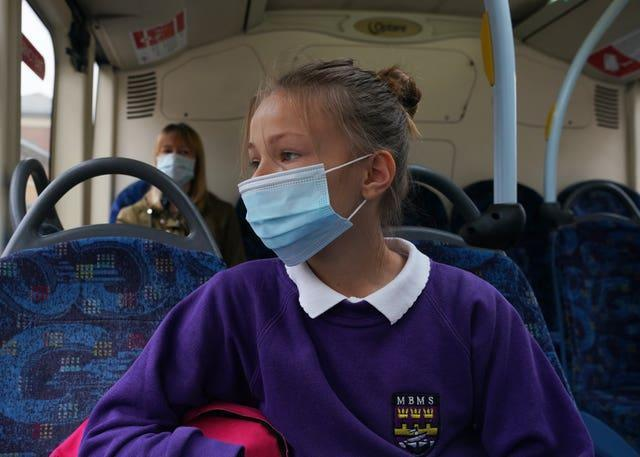 (Permission granted) A school pupil wearing a face mask on a bus in Newcastle (Owen Humphreys/PA)