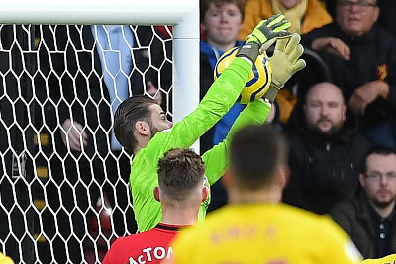 Manchester United's Spanish goalkeeper David de Gea fumbles a shot from Watford's Senegalese midfielder Ismaila Sarr into his own net during the English Premier League football match between Watford and Manchester United at Vicarage Road Stadium in Watford, north of London on December 22, 2019. (Photo by DANIEL LEAL-OLIVAS / AFP) / RESTRICTED TO EDITORIAL USE. No use with unauthorized audio, video, data, fixture lists, club/league logos or 'live' services. Online in-match use limited to 120 images. An additional 40 images may be used in extra time. No video emulation. Social media in-match use limited to 120 images. An additional 40 images may be used in extra time. No use in betting publications, games or single club/league/player publications. / (Photo by DANIEL LEAL-OLIVAS/AFP via Getty Images)