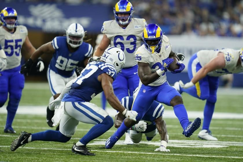 Los Angeles Rams' Sony Michel (25) runs against Indianapolis Colts' Khari Willis (37) during the second half of an NFL football game, Sunday, Sept. 19, 2021, in Indianapolis. (AP Photo/Michael Conroy)