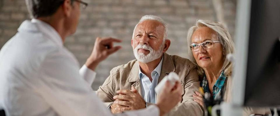 Senior couple having consultation with a doctor.