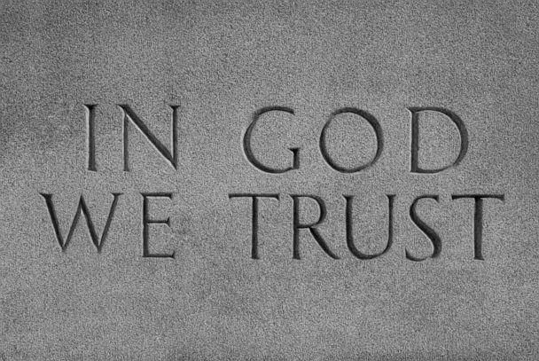 PHOTO: In this undated file photo, the saying 'In God We Trust' is shown inscribed on a wall. (William Sherman/Getty Images, FILE)