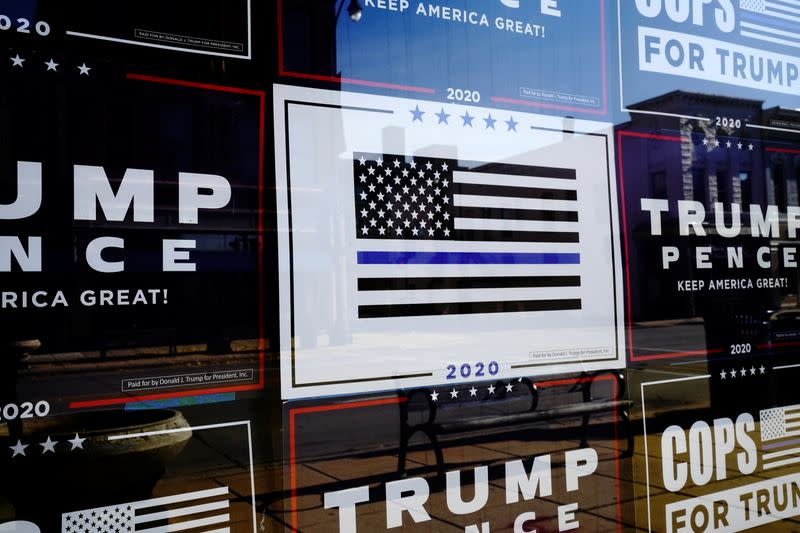 Signs supporting U.S. President Trump and Vice President Pence are displayed in Racine