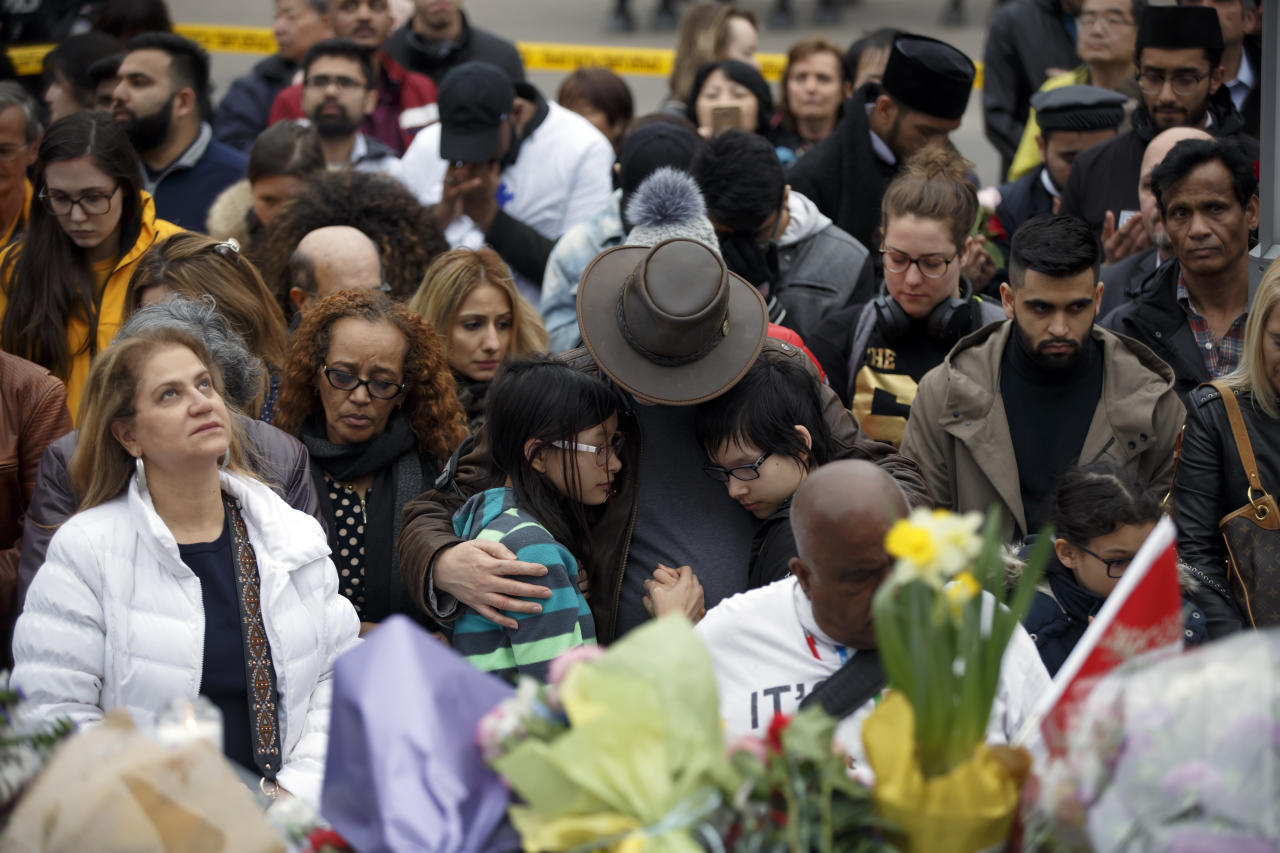 <p>People gather at a memorial for victims of the mass killing on Yonge Street at Finch Avenue on April 24, 2018 in Toronto. Cole Burston/Getty Images </p>