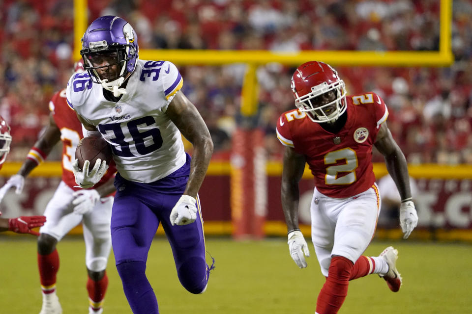Minnesota Vikings running back A.J. Rose Jr. (36) runs past Kansas City Chiefs cornerback Dicaprio Bootle (2) on his way to a 32-yard touchdown run during the second half of an NFL football game Friday, Aug. 27, 2021, in Kansas City, Mo. (AP Photo/Ed Zurga)