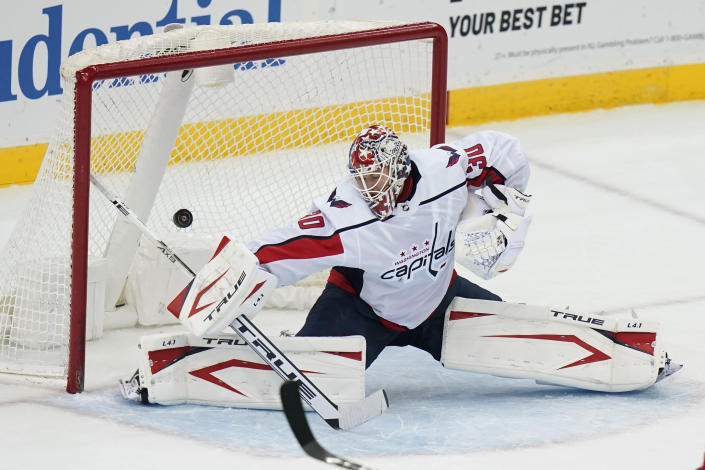 Washington Capitals goaltender Ilya Samsonov gives up a goal to New Jersey Devils' Travis Zajac during the third period of an NHL hockey game Sunday, April 4, 2021, in Newark, N.J. (AP Photo/Frank Franklin II)