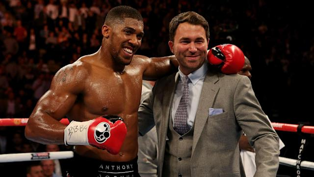 Eddie Hearn (R) is planning to start talks on a mouth-watering bout between Anthony Joshua (L) and Deontay Wilder. (Reuters)