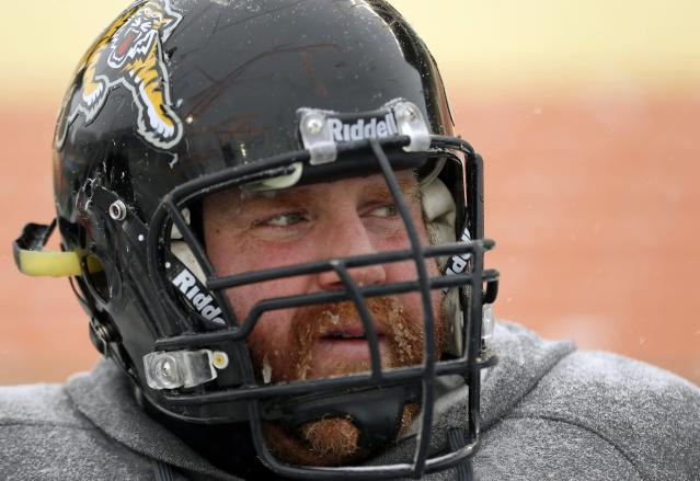 Hamilton Tiger-Cats' Tim O'Neill tries to keep warm with a frosty face during the team practice in Regina, Saskatchewan, November 20, 2013. The Saskatchewan Roughriders will play the Hamilton Tiger-Cats in the CFL's 101st Grey Cup in Regina November 24. REUTERS/Todd Korol (CANADA - Tags: SPORT FOOTBALL)