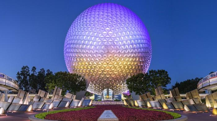 Epcot's Spaceship Earth as monorails wrap around it.