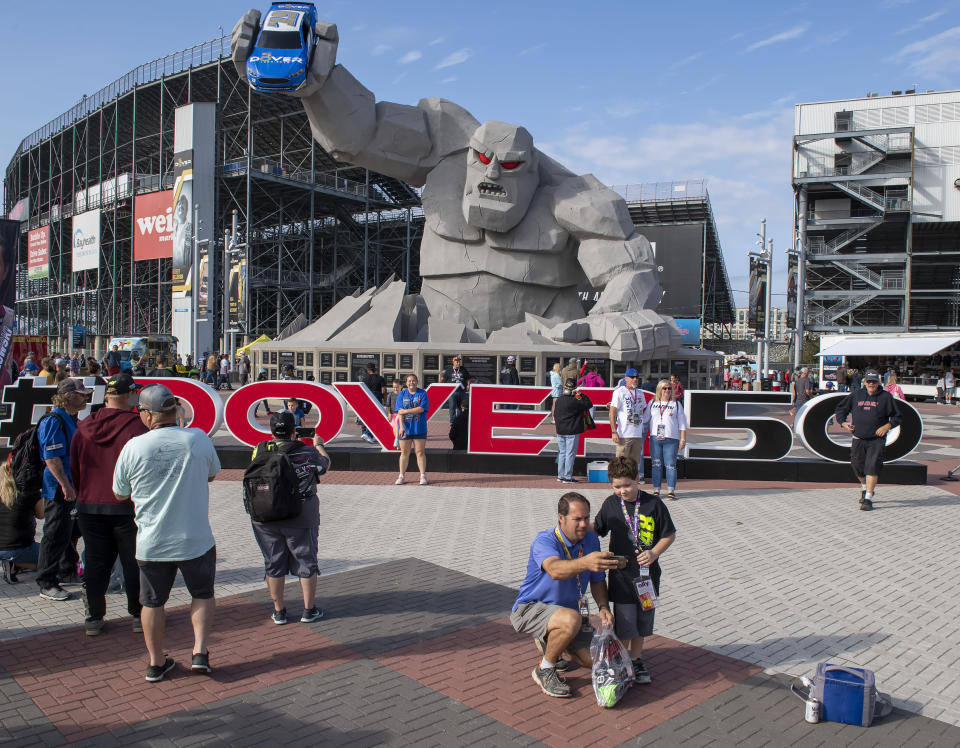 NASCAR fans take photos in front of Miles the Monster before the Drydene 400 - Monster Energy NASCAR Cup Series playoff auto race, Sunday, Oct. 6, 2019, at Dover International Speedway in Dover, Del. (AP Photo/Jason Minto)