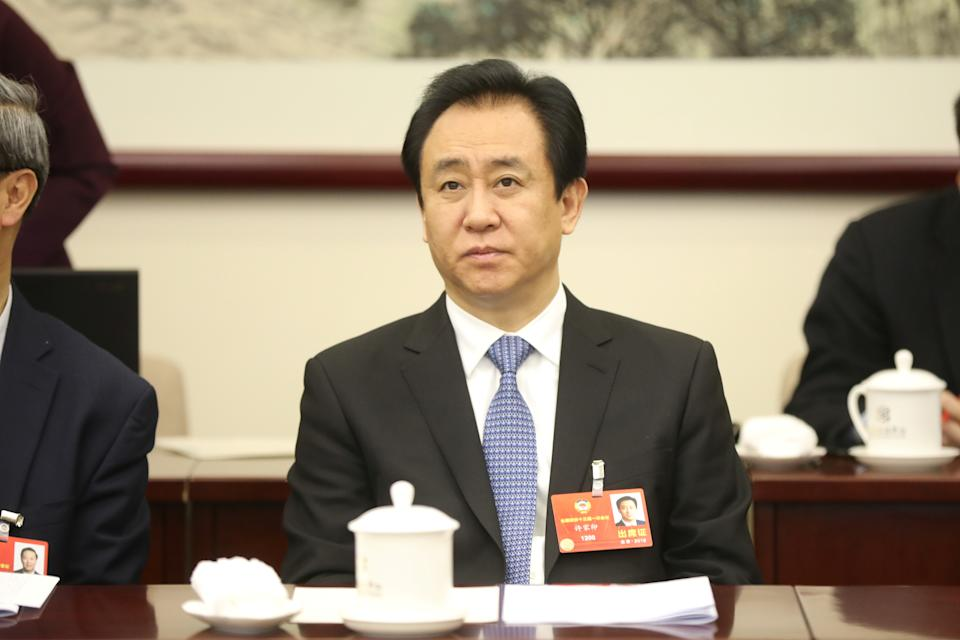 Evergrande Group Chairman Xu Jiayin attends a panel discussion of the National Committee of the Chinese People's Political Consultative Conference (CPPCC) in Beijing, China March 4, 2018. REUTERS/Stringer ATTENTION EDITORS - THIS IMAGE WAS PROVIDED BY A THIRD PARTY. CHINA OUT. NO COMMERCIAL OR EDITORIAL SALES IN CHINA.