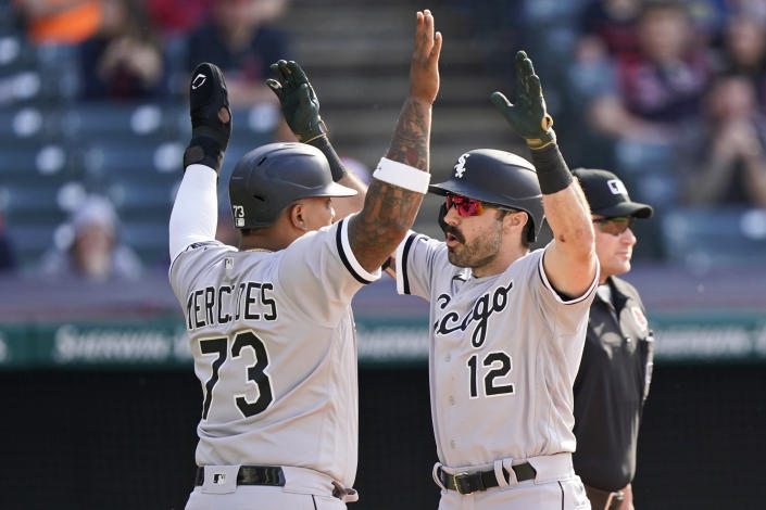 Chicago White Sox's Adam Eaton (12) and Yermin Mercedes (73) celebrate after Eaton hit a two-run home run in the eighth inning of the first baseball game of a doubleheader against the Cleveland Indians, Monday, May 31, 2021, in Cleveland. (AP Photo/Tony Dejak)