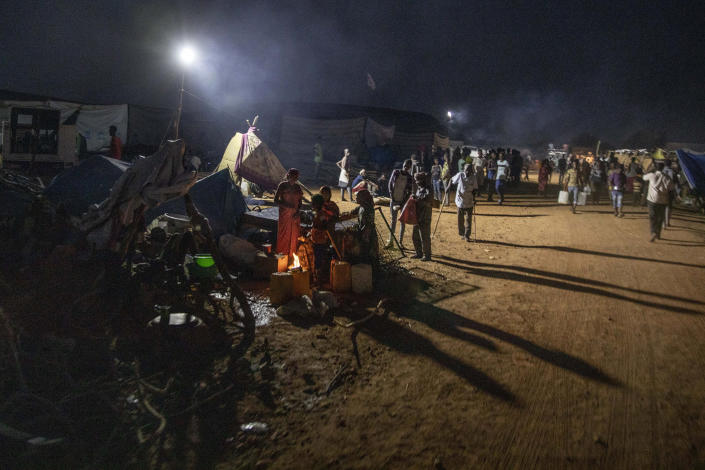 Tigray people who fled the conflict in Ethiopia's Tigray region, gather near their shelters at Umm Rakouba refugee camp in Qadarif, eastern Sudan, Thursday, Nov. 26, 2020. Ethiopia's prime minister said Thursday the army has been ordered to move on the embattled Tigray regional capital after his 72-hour ultimatum ended for Tigray leaders to surrender, and he warned the city's half-million residents to stay indoors and disarm. (AP Photo/Nariman El-Mofty)