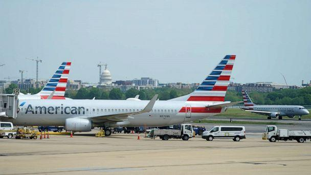 PHOTO: An American Airlines Boeing 737 jet sits at a gate at Washington's Reagan National airport with the U.S. Capitol building in the background, in Washington, April 29, 2020. (Kevin Lamarque/Reuters, FILE)