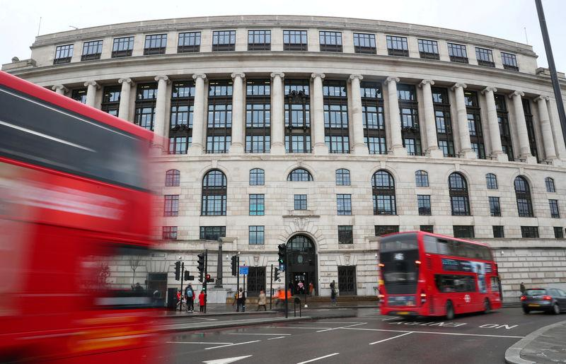 FILE PHOTO: Traffic and people pass by the front of the Unilever building in central London